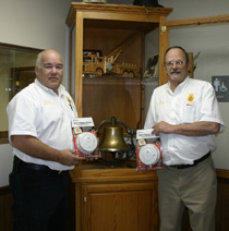 Left to right: Fire Prevention Officer & Captain Don Stevens, and Lafayette Fire Chief Keith Scruggs are pictured holding the free smoke detectors. (Photo by D. Gregory)