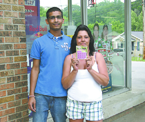 Employee Linda King and Mr. Patel are pictured holding a Lady Jumbo Lottery ticket.