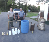 Pictured above are Officers Anthony Warner and Darrell Taylor of the Macon County Sheriff's Department with the moonshine still they recently recovered. (Photo by: J. Williams)