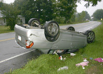 Megan Bennett, of Tompkinsville, Ky., lost control of her Chevy Malibu on the Gamaliel Road early Monday morning, and flipped it twice. (Photo by K. Belle)