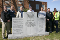 Pictured left to right: Macon County Sheriff Mark Gammons, Lafayette Fire Chief & EMA Director Keith Scruggs, County Mayor Shelvy Linville, Macon County Emergency Medical Services Director Randall Kirby, City Mayor Richard Driver, Lafayette Police Chief Stacy Gann, and Macon County Rescue Squad Director and Assistant EMA Director Don Stevens. (Photo by D. Gregory)