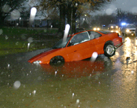 Flooding was reported out in the county as well as inside the city limits. The LPD had to handle traffic late Sunday afternoon until this car was towed out of the high water at the intersection of Ellington and Meador Drive. (Photo by D. Gregory)