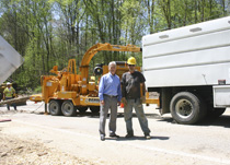 Mayor Shelvy Linville is pictured on the Highway 10 South Hill with a crew worker last Wednesday. (Photo by D. Gregory)