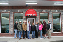 Pictured are Joyce Gregory, Chris Crowder, Donnie Andrews, store employees and future customers. (Photo by D. Gregory)