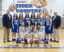 On Feb 20th the Macon County Junior High Girls Basketball team won the TNT Class 4A State Tournament in Springfield, TN. Pictured is the 2015-2016 team and their coaches Shawn Carter and Gary Carter. (Photo by Jullie Collins of Mrs Julie's Photography)