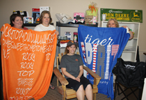 Lafayette Lioness Lions Club members Monica Gann, Melissa Shrum and Debbie & Hannah Hughes show off some of the items that will be up for grabs during the 20th annual Lafayette Lions & Lioness Lions Club Radio Auction, Oct. 17-19. (Photo by: J. Williams)