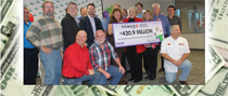 Pictured above, are the 20 winners of the $420.9 million Powerball ticket.