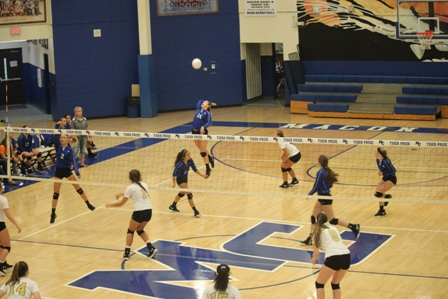 MCHS Volleyball Splits Games