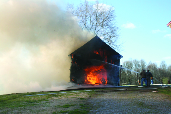 Fire Destroys Outbuilding, Threatens Home