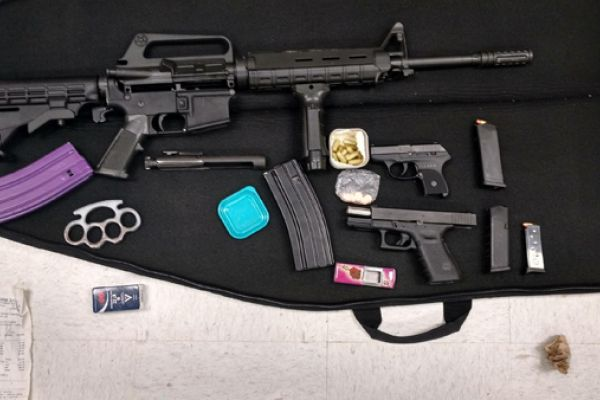Two Arrested: Drugs & Guns Seized